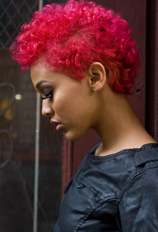 picture of light skinned black female with natural hair.